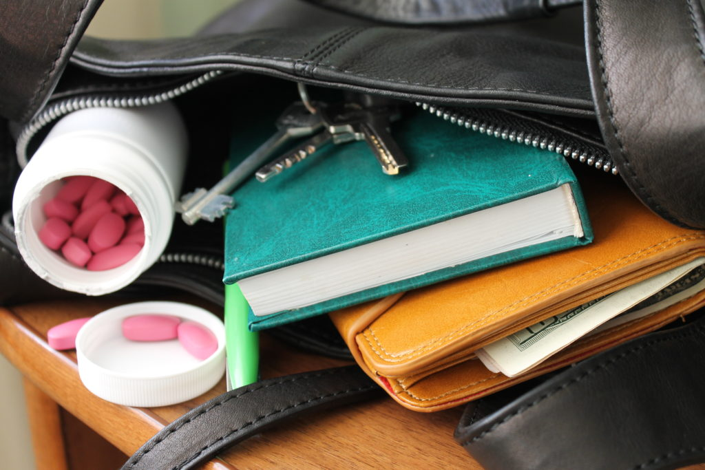 Bag with pills and wallet