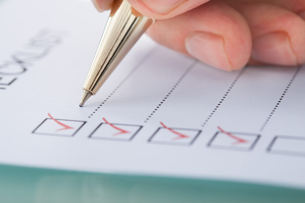 Person checking boxes on a list